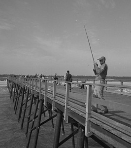 A Brown OBX 3 men fishing from pier